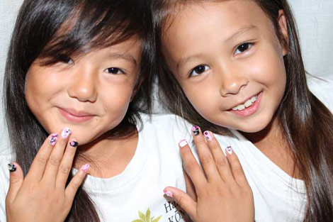 Young S Enjoying Making Their Own Nail Stickers