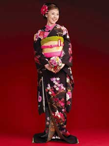 67697d781 A strikingly elegant black hikifurisode combined with a western hairstyle.  (C)Tsuruya Bridal Salon