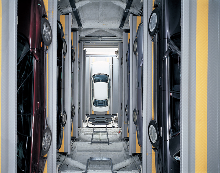 Looking down the inside of an automated parking garage. Some facilities carry automobiles up and down at speeds of over 100 meters per minute.  ©Japan Parking System Manufacturers Association Incorporated