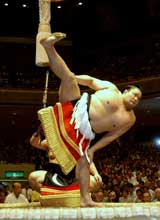 Sumo champion Takanohana performs a ring ...